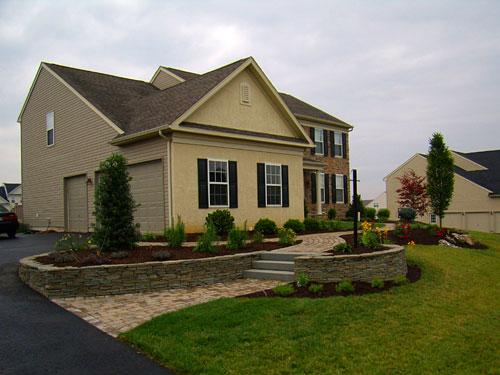 Entrance - Stone walls and paver walkway